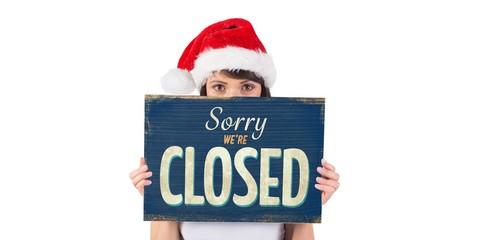 Santa girl holding closed sign