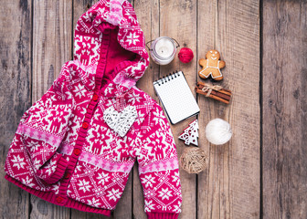 Christmas set. Warm blanket, sweater, candle, notebook, spices, cinnamon, pine cones, heart  on the wooden background