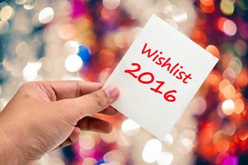 Wishlist 2016 handwriting on a sticky note