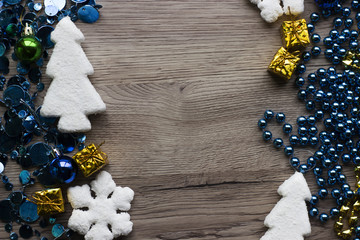 Holiday decorations closeup on wooden background with space for text