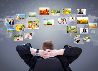 Businessman siting and looking at photo gallery images