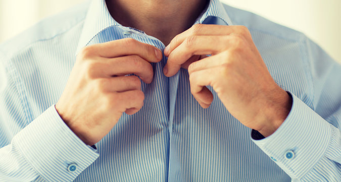 close up of man in shirt dressing