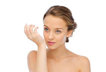 woman smelling perfume from wrist of her hand