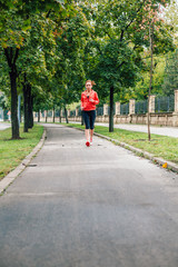 Woman running on the concrete track