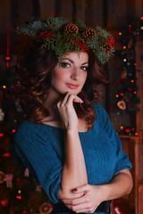beautiful girl in a New Year's wreath