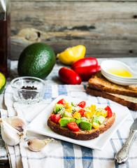 toast with fresh avocado, tomato and corn