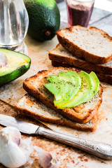 toast with fresh avocado and pepper, healthy snack, vegetarian f