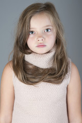 Portrait of a little girl with long hair..