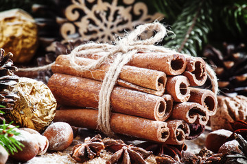 Bunch of cinnamon sticks in a Christmas composition with walnuts
