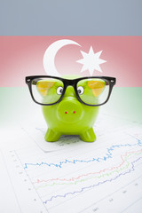 Piggy bank with flag on background - Azerbaijan