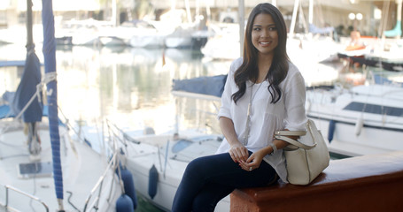 Woman Relaxing On Bench In Yacht Port