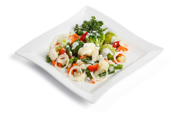 Salad with vegetables, on a white