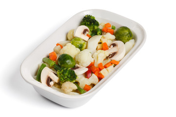 Steamed vegetables, on a white
