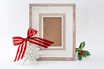 Photo frame with red ribbon isolated on white