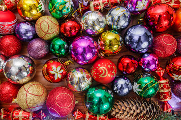 Many colored Christmas toys on a table