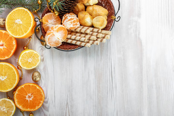 Citrus cut in half and a basket of sweets bread on the table