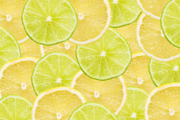Lemon and lime slices background.
