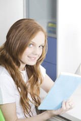 Happy teen student with book