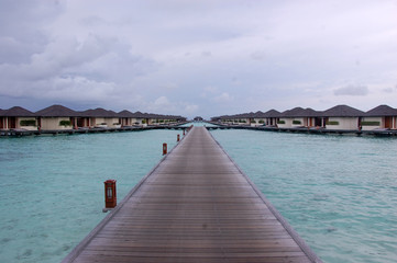 Timber pier and bungalow at Paradise Island Resort Maldives
