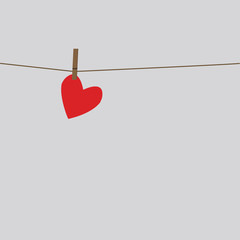 the heart hangs on a string pinned clothespin
