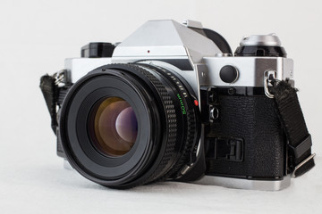 Retro vintage camera on a white background with selective focus