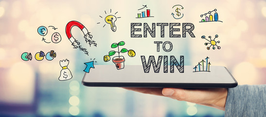 Enter To Win concept with man holding a tablet