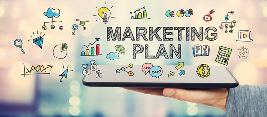 Marketing Plan concept with man holding a tablet