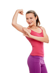 woman smiling fitness portrait. showing biceps