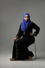 Malaysian malay woman posing with different normal and smiling expression with arabic theme look