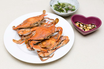 Boiled blue crabs with sauces