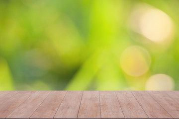 Wood table top on abstract bokeh and blurred background. ready for product display