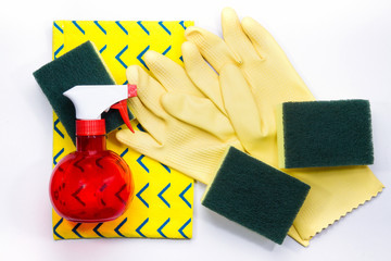 Yellow rubber gloves and scrubber sponges on yellow cleaning nap