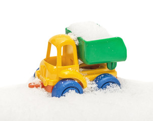 Child's toy truck in snow, covered snow, isolated on the white