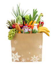 A paper bag full of groceries / studio photography of brown grocery bag with fruits, vegetables, bread, bottled beverages - isolated over white background