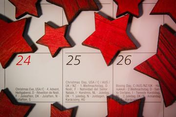 Weihnachten auf Kalender mit 11 roten Sternen