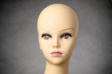 Mannequin head on dark grey background