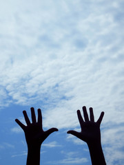 hands silhouettes and blue sky