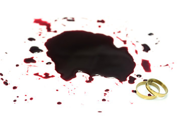 Pair of wedding gold ring and red blood on white background ,Murder concept