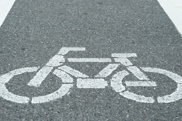 Bicycle lane sign, white chalk painted on street