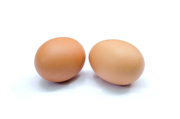 two brown chicken eggs isolated set horizontal on white background