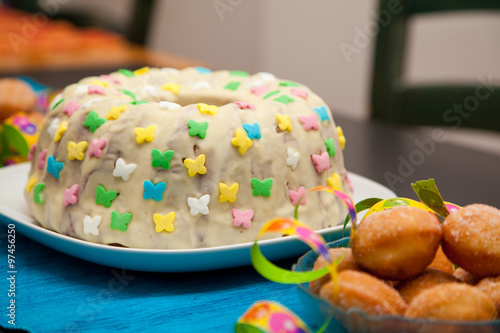 Birthday Cake On A Blue Table Cloth
