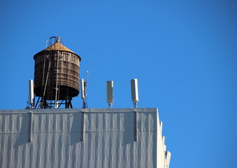 Top Wooden Water Tank Container with Blue Sky