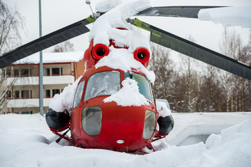 The Old red helicopter in snow.