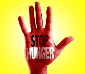 Stop Hunger written on hand with yellow background