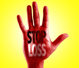 Stop Loss written on hand with yellow background
