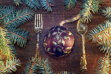 Christmas tree with baubles on wood texture.