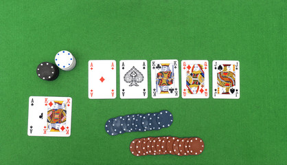 Playing cards isolated on green background,