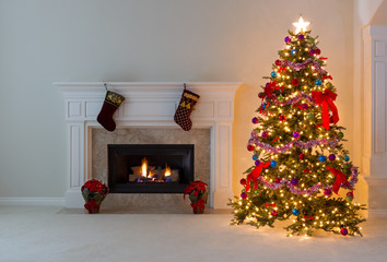 Bright Christmas tree with burning fireplace