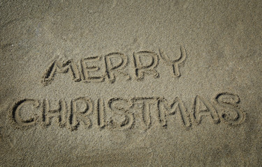 Merry Christmas write in sand