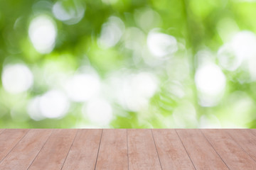 Wood table top on blurred nature abstract background. ready for product display